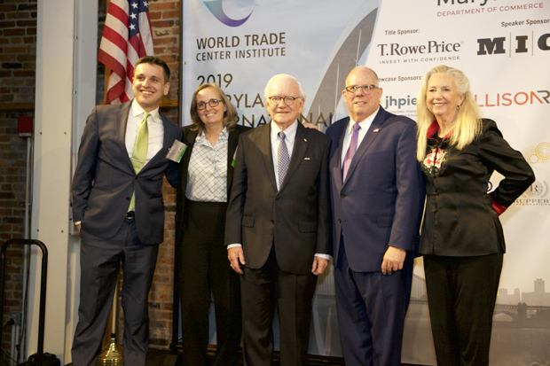 Harold Adams, center, chairman emeritus of the World Trade Center Institute, is joined on stage by, from left, Eddie Resende, chief operations officer of the WTCI; Susan Aplin, WTCI's chief innovation officer; Gov. Larry Hogan; and Deb Kielty, CEO of the WTCI. (Photo courtesy of the World Trade Center Institute)