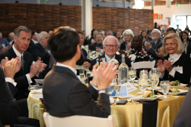 Harold Adams, center, chairman emeritus of the World Trade Center Institute, receives an ovation from guests at the 23rd Maryland International Business Leadership Awards. (Photo courtesy of the World Trade Center Institute)