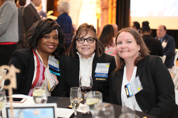From left, BD Diagnostic Systems colleagues Lisa Dagnatchew, Rose Mary Casados and Kristen Weaver enjoy the festivities at the American Visionary Art Museum in Baltimore. (Photo courtesy of the World Trade Center Institute)