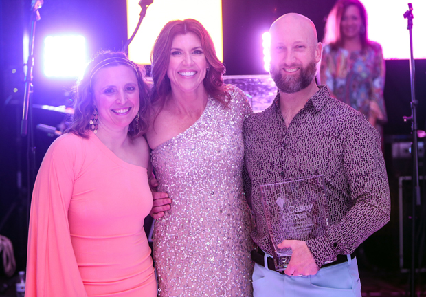 Casey Baynes, center, founder of the Casey Cares Foundation, poses for a photo with Champion of Children Award winners Abby Beares and David Beares. (Photo by Mike Buscher)