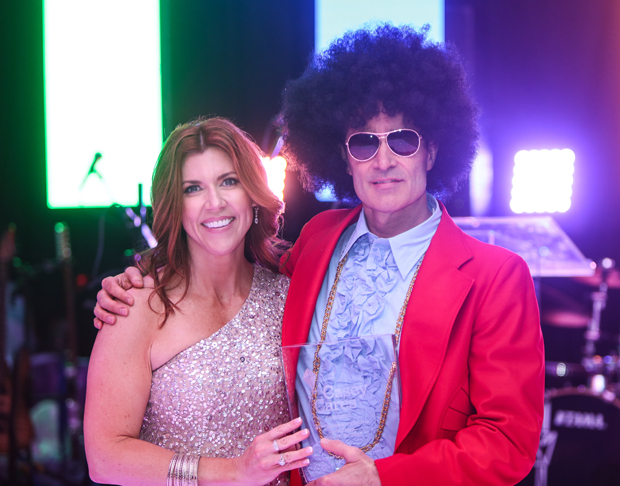 David Trapp, decked out in his finest Studio 54-era costume, gets a photo with Casey Baynes, founder of the Casey Cares Foundation. Trapp was one of the Champion of Children Award recipients. (Photo by Mike Buscher)