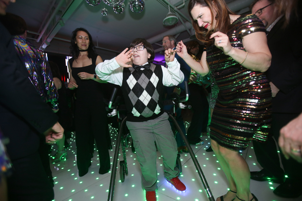 Casey Cares Kid Simon Hatcher and his mom Laura Hatcher burn up the dance floor at the American Visionary Arts Museum in Baltimore. (Photo by Mike Buscher)