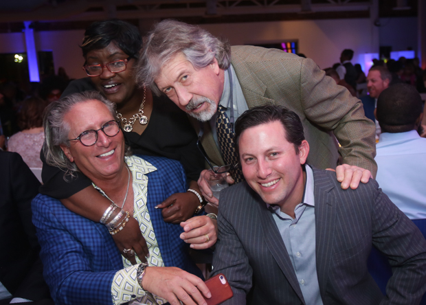 Gala chair and board president Bob Weltchek, left, enjoys the festivities with Pamela Leak, Joe Howard, and his son, Nolan Weltchek. (Photo by Mike Buscher)