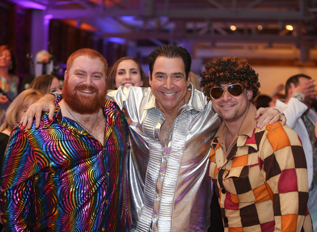The DiMayo family have a groovy time at the Casey Cares Foundation's Studio 54 Gala. From left are Michael DiMayo, Andrea DiMayo, chairman of the board Mike DiMayo and David DiMayo. (Photo by Mike Buscher)