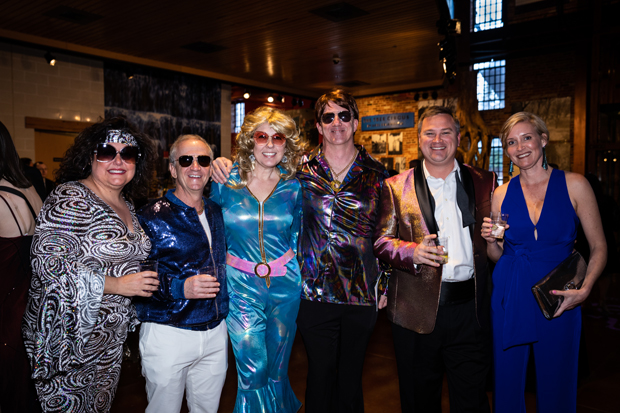 The costume contest was a big hit for guests at the Casey Cares Foundation's Studio 54 Gala. Getting into the 1970s spirit were, from left, Beth Rosenwald, Peter Rosenwald, Amanda Wilhelm, Jim Wilhelm, board member Brad Rodier and Jill Stallings. (Photo by Yumi Okamoto)