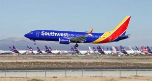 FILE - In this March 23, 2019 file photo a Southwest Airlines Boeing 737 Max aircraft lands at the Southern California Logistics Airport in the high desert town of Victorville, Calif.   (AP Photo/Matt Hartman, File)