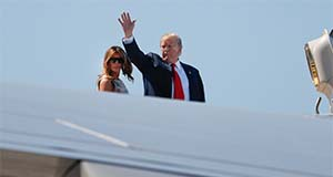 President Donald Trump, right, waves as he and first lady Melania Trump board Air Force One prior to departure from Palm Beach International Airport, Sunday, April 21, 2019, in West Palm Beach Fla. (AP Photo/Pablo Martinez Monsivais)