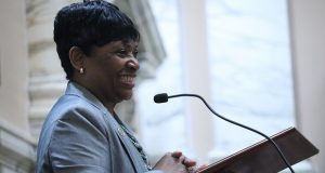 House Speaker Adrienne Jones smiles after being elected the first woman and first black lawmaker to win the office during a special session on Wednesday, May 1, 2019 in Annapolis, Maryland. (AP Photo/Brian Witte)