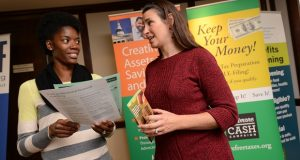 11-8-2016 BALTIMORE, MD- The Baltimore CASH Campaign is using a grant from the Consumer Financial Protection Bureau to offer financial coaching to veterans. The program is led by a certified financial coach who is also a military spouse, Wyneca Pruett, left, seen with Sara Johnson, Director of Baltimore CASH Campaign.   (The Daily Record/ Maximilian Franz).