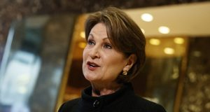 FILE - In this Jan. 13, 2017, file photo Lockheed Martin CEO Marillyn Hewson talks to reporters in the lobby of Trump Tower in New York after a meeting with President-elect Donald Trump. At $21.5 million, Hewson was the second highest-paid female CEO for 2018, as calculated by The Associated Press and Equilar, an executive data firm. (AP Photo/Evan Vucci, File)