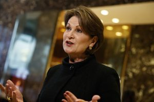 In this Jan. 13, 2017 photo, Lockheed Martin CEO Marillyn Hewson talks to reporters in the lobby of Trump Tower in New York after a meeting with President-elect Donald Trump. At $21.5 million, Hewson was the second highest-paid female CEO for 2018, as calculated by The Associated Press and Equilar, an executive data firm. (AP Photo/Evan Vucci, File)