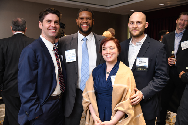 2019 Leadership in Law winners Sara Cline, front, a shareholder with Shulman Rogers, and Ryan J. Dymek, of the Law Office of Ryan J. Dymek LLC, pose with past winner William Carl Isler II, program counsel with Legal Services Corporation, and Brandon Lane, with Shulman Rogers. (Photo by Maximilian Franz)