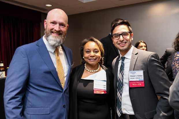 2019 Leadership in Law winners Kelby Brick, with the Governor's Office of the Deaf and Hard of Hearing; Sharonne R. Bonardi, with the office of the Comptroller of Maryland; and Generation J.D. winner Emmanuel A. Fishelman, an attorney with Antezana & Antezana LLC, pose during the VIP networking reception. (Photo by Maximilian Franz)