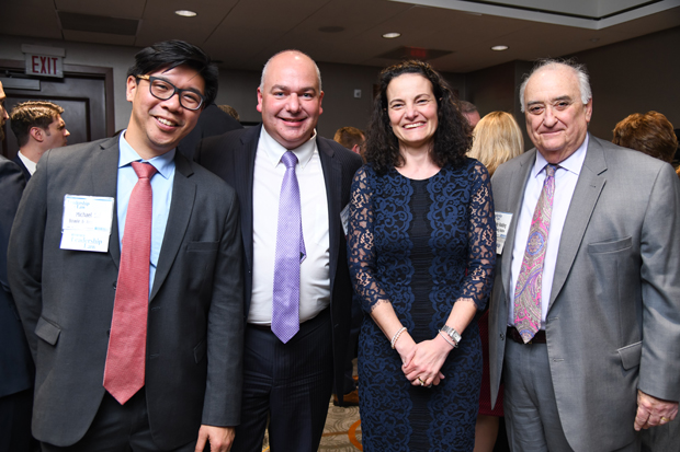 Past Leadership in Law winner Michael Siri, a member with Bowie & Jensen; 2019 Leadership in Law winner Matthew A.S. Esworthy, a partner with Bowie & Jensen LLC; Suzanne Fischer-Huettner, publisher The Daily Record; and past winner Andy Radding, a member with Adelberg Rudow, pause during the VIP reception. (Photo by Maximilian Franz)