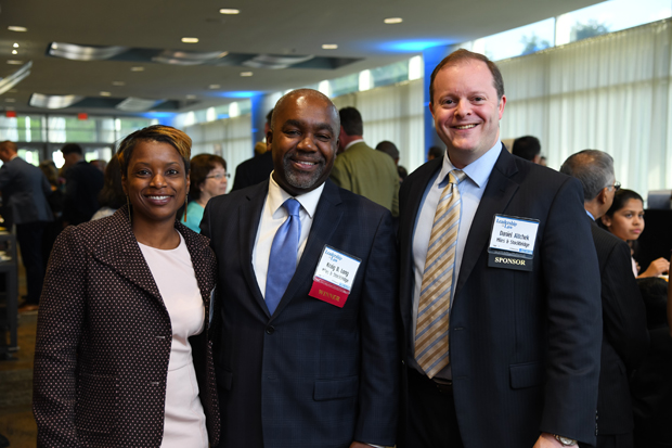 Liza Long, 2019 Leadership in Law winner Kraig B. Long, a principal with Miles & Stockbridge, and Daniel Altcheck stop during the networking reception. (Photo by Maximilian Franz)