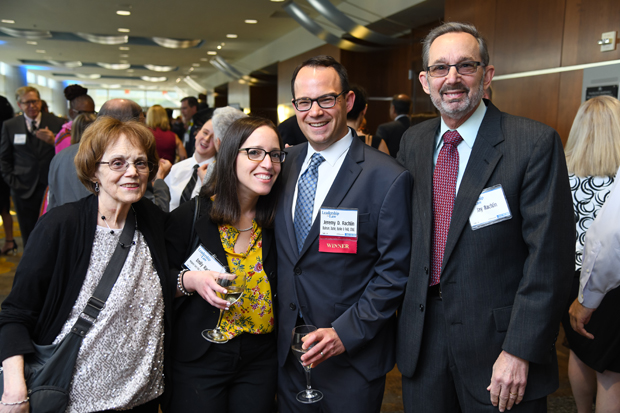 2019 Leadership in Law winner Jeremy D. Rachlin, third from left, stands with family members Randy Rachlin, Emily Rachlin and Jay Rachlin. (Photo by Maximilian Franz)