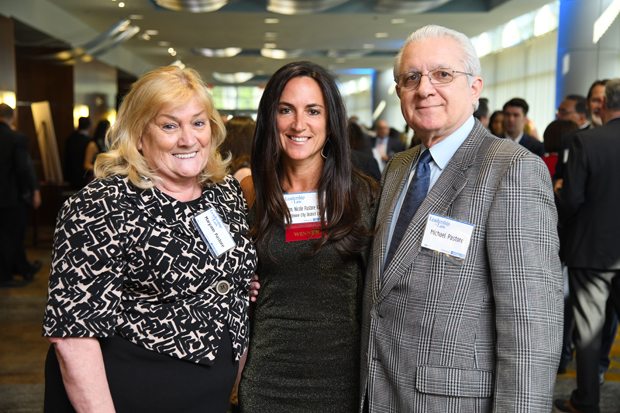 2019 Leadership in Law winner Judge Nicole Pastore Klein, an associate judge on the First District Court in Baltimore, stands with her parents Maryann and Michael Pastore. (Photo by Maximilian Franz)