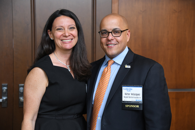 Michelle Daugherty Siri, executive director of the Women's Law Center of Maryland, gets a photo with Victor Velazquez, executive director of the Maryland State Bar Association. (Photo by Maximilian Franz)