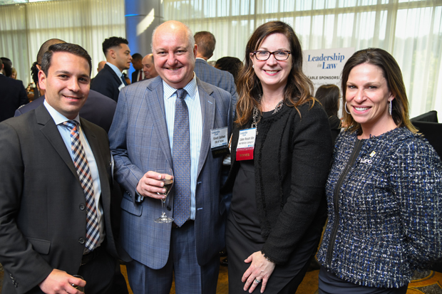2019 Leadership in Law winner Colleen Pleasant Kline, third from left, outside general corporate counsel with Nelson Mullins Riley & Scarborough LLP, stands with Harris Eisenstein, a partner with Rosenberg Martin Greenberg LLP; Street Baldwin, director of audit and accouting with Ellin & Tucker; and Annette Walters. (Photo by Maximilian Franz)