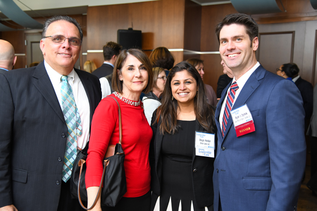 2019 Leadership in Law winner Ryan J. Dymek, right, of the Law Office of Ryan J. Dymek LLC, poses with Joseph Dymek, Cathy Dymek and past Leadership in Law winner Divya Potdar, founder of Diva Law LLC. (Photo by Maximilian Franz)
