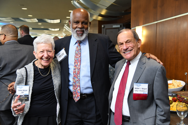 2019 Lifetime Achievement winner Herbert J. Belgrad, right, a partner with Tydings & Rosenberg LLP, stands with his wife, Joanne Belgrad, and Wilhelm H. Joseph Jr., Esq., executive director of Maryland Legal Aid. (Photo by Maximilian Franz)