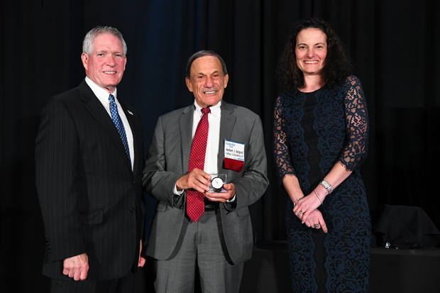 2019 Lifetime Achievement winner Herbert J. Belgrad, center, a partner with Tydings & Rosenberg LLP, receives his award from MSBA president Judge Keith R. Truffer, an associate judge in the Baltimore County Circuit Court, and Suzanne Fischer-Huettner, Publisher of The Daily Record. (Photo by Maximilian Franz)