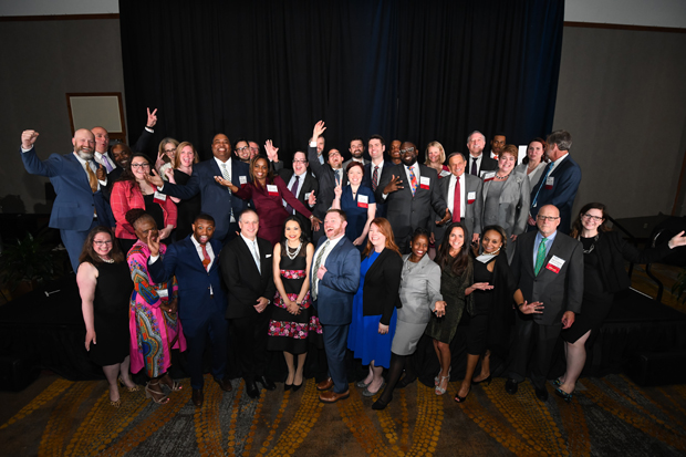 The 2019 Daily Record Leadership in Law winners gather on stage for a group photo during the awards ceremony at the Hilton BWI Airport hotel. (Photo by Maximilian Franz)