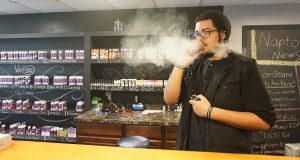VAPE180 supervisor Devin Farmer said  he may have to turn some of his customers away once the smoking age is raised. However, he says his store in Annapolis should be able to stay in business. (Capital News Service/Charlie Youngmann )