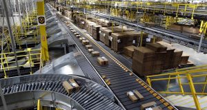 Packages ride on a conveyor system at an Amazon fulfillment center in Baltimore.  (AP Photo/Patrick Semansky)