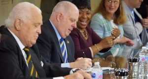 "From left, Senate President Thomas V. ""Mike"" Miller, Gov. Larry Hogan and House Speaker Adrienne Jones sign bills Monday in Annapolis. (The Daily Record / Bryan P. Sears)"