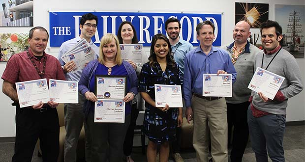 The Daily Record received 23 awards, including one Best of Show award, in the Maryland Delaware District of Columbia Press Association's 2018 editorial, design and revenue contests. Pictured are, from left, first row, Patrick Brannan, special products editor; Tracy Bumba, audience development director; Anamika Roy, Steve Lash and Adam Bednar, reporters; second row, Jason Whong, digital editor; Heather Cobun, Tim Curtis and Bryan P. Sears, reporters. (The Daily Record / Tom Baden)