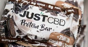 A cookies and cream flavored protein bar marketed by JustCBD is displayed at the Cannabis World Congress & Business Exposition trade show, Thursday, May 30, 2019 in New York. (AP Photo/Mark Lennihan)