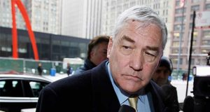 FILE - In this Jan. 13, 2011 file photo, Conrad Black arrives at the federal building in Chicago. President Donald Trump has granted a full pardon to Black, a former newspaper publisher who has written a flattering political biography of Trump. Black's media empire once included the Chicago Sun-Times and The Daily Telegraph of London. (AP Photo/Charles Rex Arbogast, File)