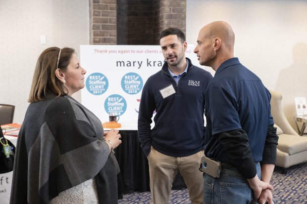 Lisa Benson, left, president and CEO of Mary Kraft Staffing and HR Solutions, speas with Anthony Marcantoni and Thomas Castagna of F&M Contractors Inc. during the Insight ConneX AM breakfast. (Photo by John Coyle)