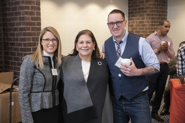 From left, Katie Brandt, leadership and team development coach at Altius Research and Consulting; Lisa Benson, president and CEO of Mary Kraft Staffing and HR Solutions; and Bob Gillespie, design president and creative director at Propr, pose for a photo. (Photo by John Coyle)