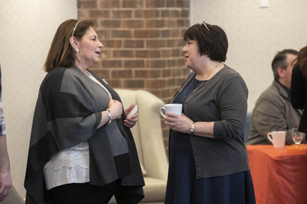 Lisa Benson, left, president and CEO of Mary Kraft Staffing and HR Solutions, chats with Ellen Torres, director of development for the Alzheimer's Association of Maryland. (Photo by John Coyle)