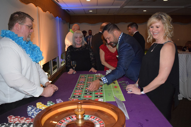Steve Linkous, president and CEO of Harford Mutual Insurance Companies, places a bet at the roulette table as Sue Manning, a business development specialist with Freedom Federal Credit Union, and Kathy Rink await the outcome. (Photo by The Arc Northern Chesapeake Region)
