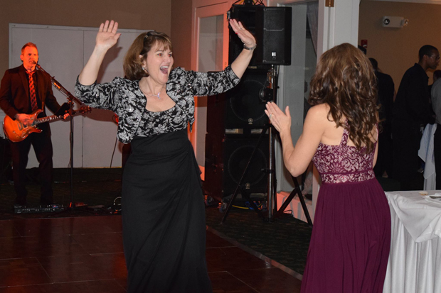 Gina Shaffer, founder of Shaffer, McLauchlin & Stover LLC and Kathy Wise, founder of Streetwise Self Defense & Personal Training, dance to live music at the 15th annual After d'Arc Gala. (Photo by The Arc Northern Chesapeake Region)