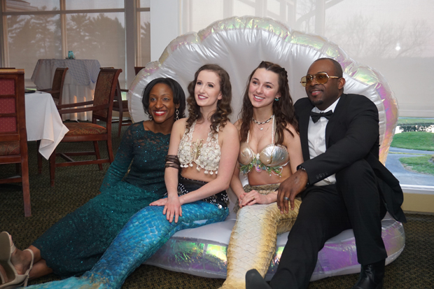 "Detra Miller, far left, business banking team leader and administrative vice president of M&T Bank, and her husband, Cory Miller, spend time with ""mermaids"" Martha Barnett and Taylor Feiss of The Magic Continues during the 15th annual After d'Arc Gala. (Photo by The Arc Northern Chesapeake Region)"