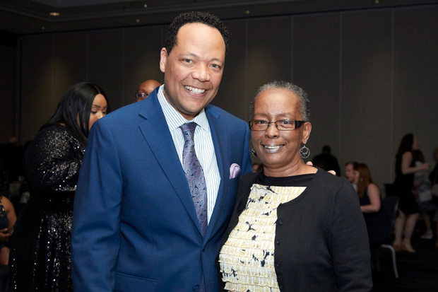 Vytas Reid, chief meteorologist with WBFF-TV, channel 45, spends time with Paula Bell, a former special assets relationship liaison III with M&T Bank, during the SBLC gala. Reid was the master of ceremonies for the fundraising event. (Photo by Tracey Brown)
