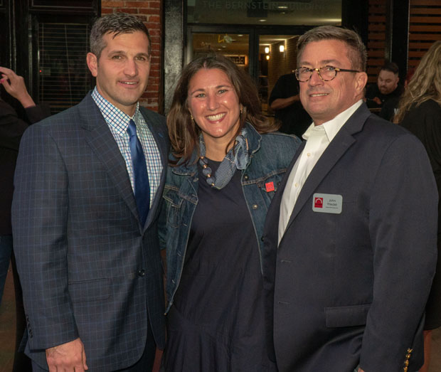 From left, Lou Kousouris, president of Artemis Properties and board president with The Baltimore Station; Christie Walsh-Myers, board vice president with The Baltimore Station; and John Friedel, executive director of The Baltimore Station, enjoy the annual Homerun for Recovery fundraiser. (Photo by Colin Stevens)
