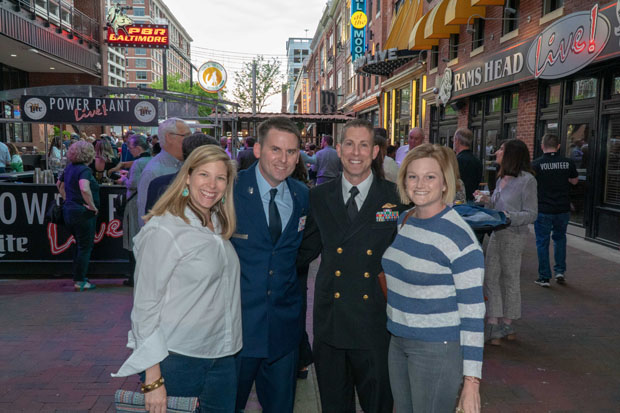 From left, Emily Hackner, an IT application manager with the University of Maryland Medical System; U.S. Air Force Senior Master Sgt. Matthew Hackner; U.S. Navy Lt. Cmdr. Matt Lipsky; and Shannon Brown enjoy the festivities at Power Plant Live in Baltimore. (Photo by Colin Stevens)