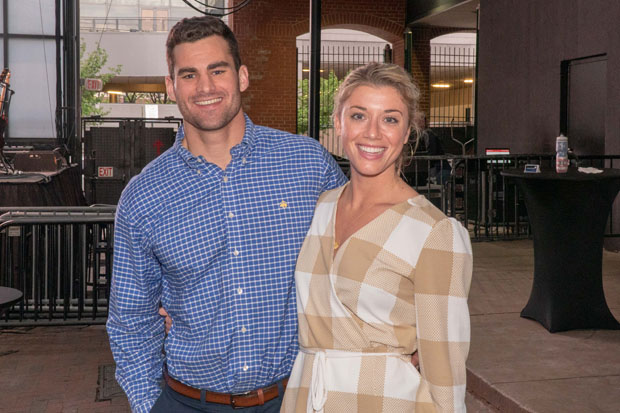 Ryan Barrett, a development coordinator with Johns Hopkins University athletics, and Emory Camper, leasing representative with MCB Real Estate LLC, attended The Baltimore Station's annual Homerun for Recovery fundraiser. (Photo by Colin Stevens)
