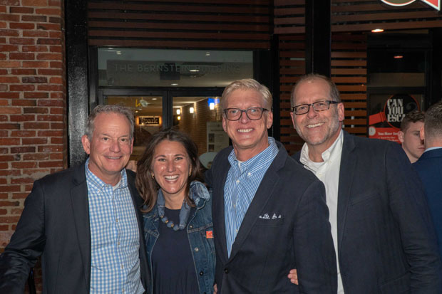 From left, Mike Myers, a partner with RK&K; Christie Walsh-Myers, vice president of the board of directors for The Baltimore Station; William Runnebaum and Bill Mangham, both with Marcus-Boyd Realty, take time for a photo during the Homerun for Recovery fundraiser. (Photo by Colin Stevens)