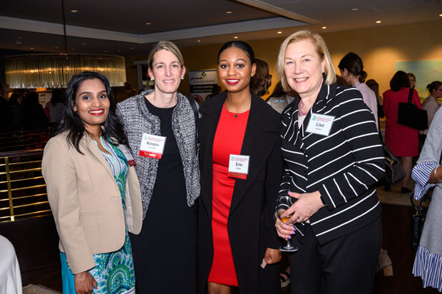 From left, Legg Mason colleagues Kavindee Edirrisinghe, a project manager; Kristin Kosmides, vice president of corporate citizenship; and Erin Phillips, internal communications; get a photo with Lisa Kruska, vice president of claims with Chesapeake Employers' Insurance Company, at The Center Club. (Photo courtesy of Glenwood Jackson Photography)
