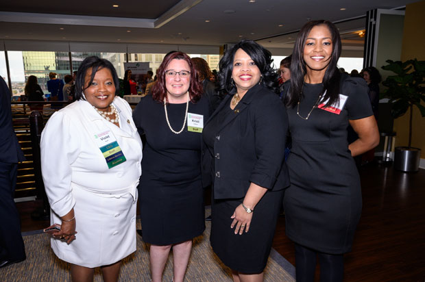 From left, Violet M. Apple, chief executive officer of Girl Scouts of Central Maryland; Kristi Halford, chief development officer of Girl Scouts of Central Maryland; Sharon Cooper-Kerr, assistant director of Women United with United Way of Central Maryland; and Ivy Gales, community market leader with SECU, pose for a photo during the awards celebration. (Photo courtesy of Glenwood Jackson Photography)