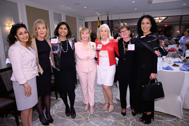 From left, Shiva Daysani, project manager at Alco Doors Inc.; Denise Koch, news anchor with WJZ-TV and a past Distinguished Woman honoree; Sheela Murthy, founder and president of Murthy Law Firm; Tere Geckle, a community philanthropist; Marianne Mattran, president and co-founder of Foundry Wealth Advisors; Julie Mercer, vice president of philanthropy and development with Bon Secours Health System; and Rhonda Overby, CEO of Camera Ready Inc., enjoy their time at the 39th annual Girl Scouts of Central Maryland's Distinguished Women's Award Celebration. (Photo courtesy of Glenwood Jackson Photography)