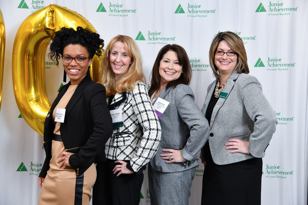 From left, Jessica Smith, owner of Jessica Smith Media; Suzanne Ricklin, vice president and head of relationship management, T. Rowe Price; Patricia Hildt, second vice president, claim management/general liability, with Travelers; and Jennifer Bodensiek, president and CEO, Junior Achievement of Central Maryland, line up for a photo during the Leading Ladies event. (Photo by Maximillian Franz)