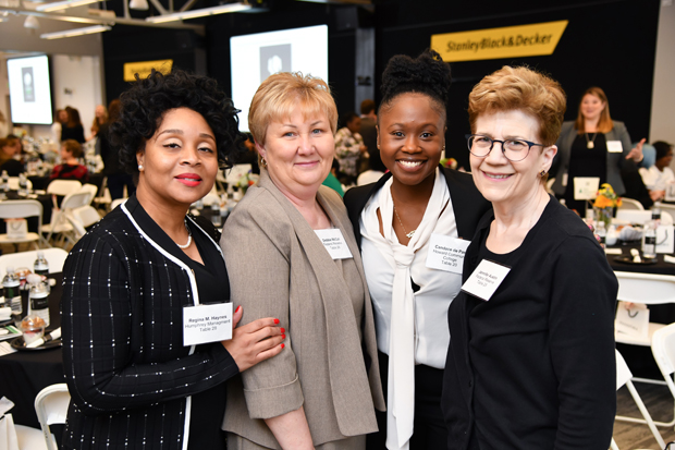 From left, Regina M. Hayes, director of education and training with Humphrey Management; Debbie McCall, with the Federal Reserve; Candace de Pass, assistant director of co-curricular programs with Howard Community College; and Jennifer Austin, of the Federal Reserve, attended Junior Achievement of Central Maryland's fifth annual Leading Ladies event. (Photo by Maximillian Franz)