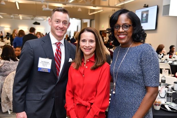 From left, Tom Sadowski, vice chancellor for economic development with the University System of Maryland; Mary Miller, former undersecretary for domestic finance with the U.S. Treasury and former director of the fixed income division with T. Rowe Price; spend time with Kelly Swoope, a news anchor with WMAR-TV, at the Leading Ladies event. Swope served as the host of the annual event. (Photo by Maximillian Franz)